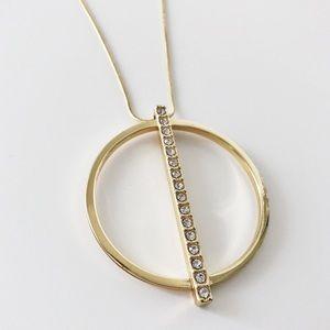 Express long gold circle pendant necklace